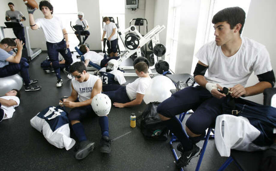 Emery-Weiner football players prepare for their six-man game against the San Antonio Lutheran School on Sept. 21. It's Emery Weiner's third year to have a team, a first for the tiny school. Photo: KAREN WARREN, Houston Chronicle