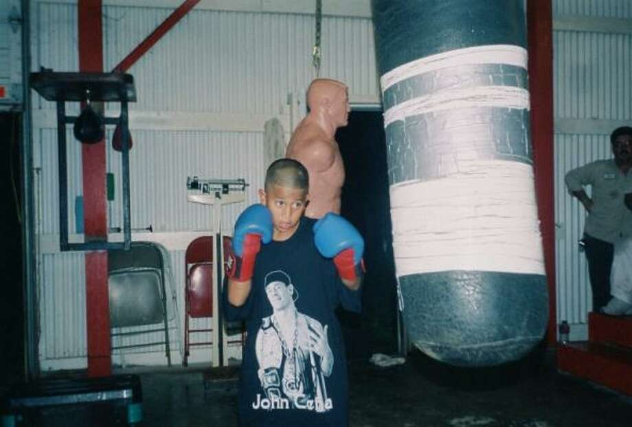 Juan Jose ``Juanito'' Peña, 9, works out on the bag at Frank's Boxing Gym. Photo: Peter Lim, For The Chronicle