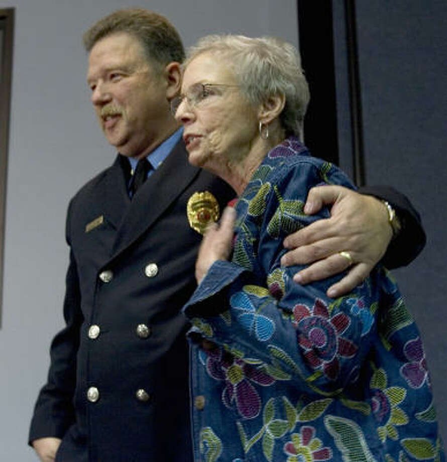 Pasadena firefighter and bone marrow donor Craig Corey and recipient Kathleen LaGarde of New Orleans meet for the first time. Photo: BRETT COOMER, CHRONICLE