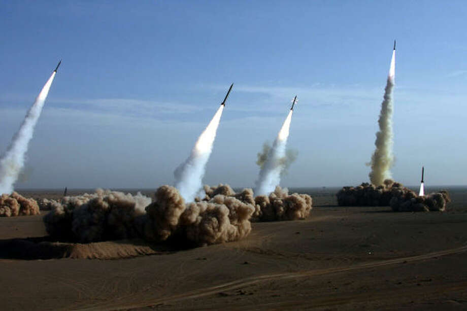 Iran's Revolutionary Guards fire test missiles during the first phase of military maneuvers Thursday in the desert outside the holy city of Qom. Photo: SAJJAD SAFARI, AP