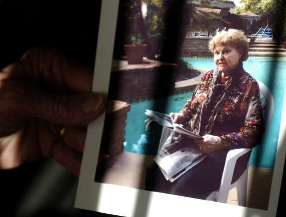 An anonymous relative holds a photo of Elfriede Rinkel, 83, of San Francisco, in September. Rinkel was deported to Germany after admitting she served as a guard at its Ravensbruck concentration camp during World War II. Photo: BENJAMIN SKLAR, AP