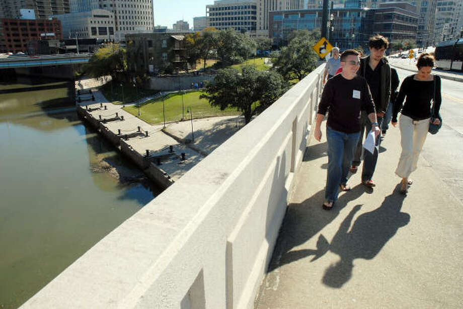 "Jim Parsons leads a group on a ""history hike"" of Allen's Landing on Sunday to encourage use of the area. The free tour was provided by the Buffalo Bayou Partnership and the Greater Houston Preservation Alliance. Photo: Dave Rossman, For The Chronicle"