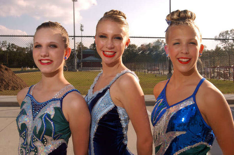 Jessica Haidar, left, Kayli Mickey and Hannah Dziuk are ready to practice their twirling routine for the College Park High School band performance. Photo: David Hopper, For The Chronicle