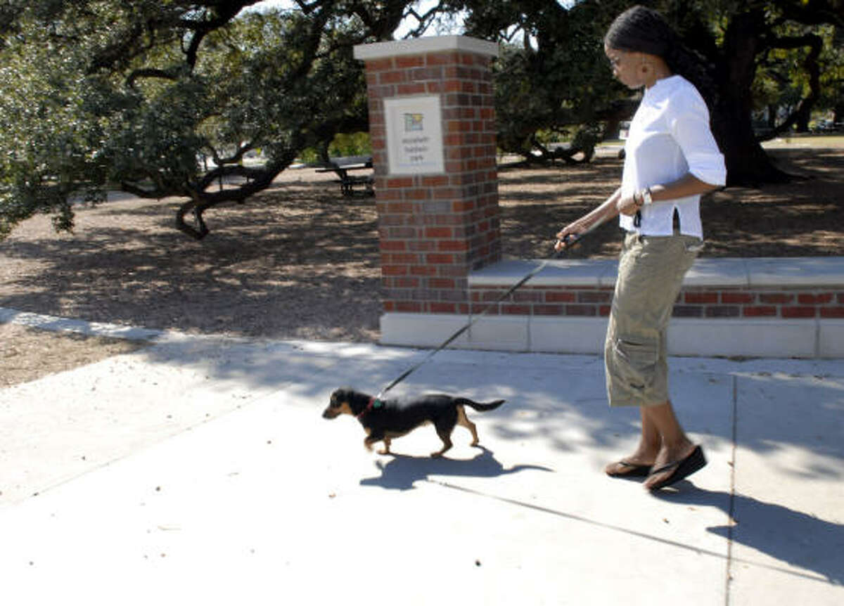 Kay Akinmade walks her dog Astro Totti in the newly renovated Baldwin Park.