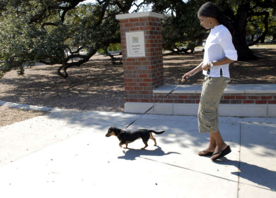 Kay Akinmade walks her dog Astro Totti in the newly renovated Baldwin Park. Photo: KIM CHRISTENSEN, For The Chronicle