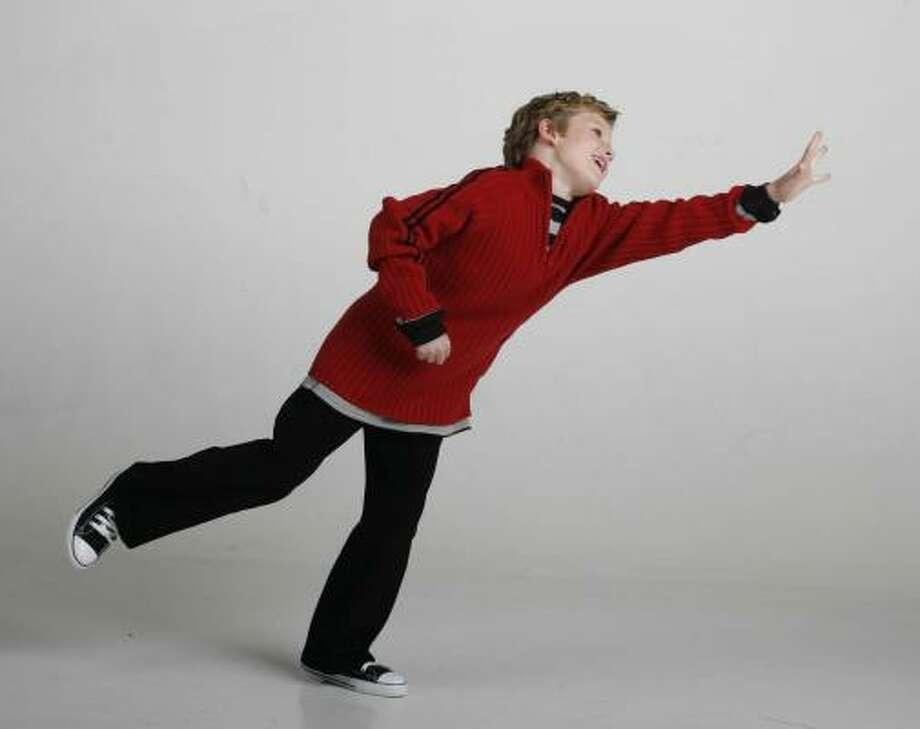 Noah Switek, 8, models holiday fashions. Photo: Billy Smith II, CHRONICLE