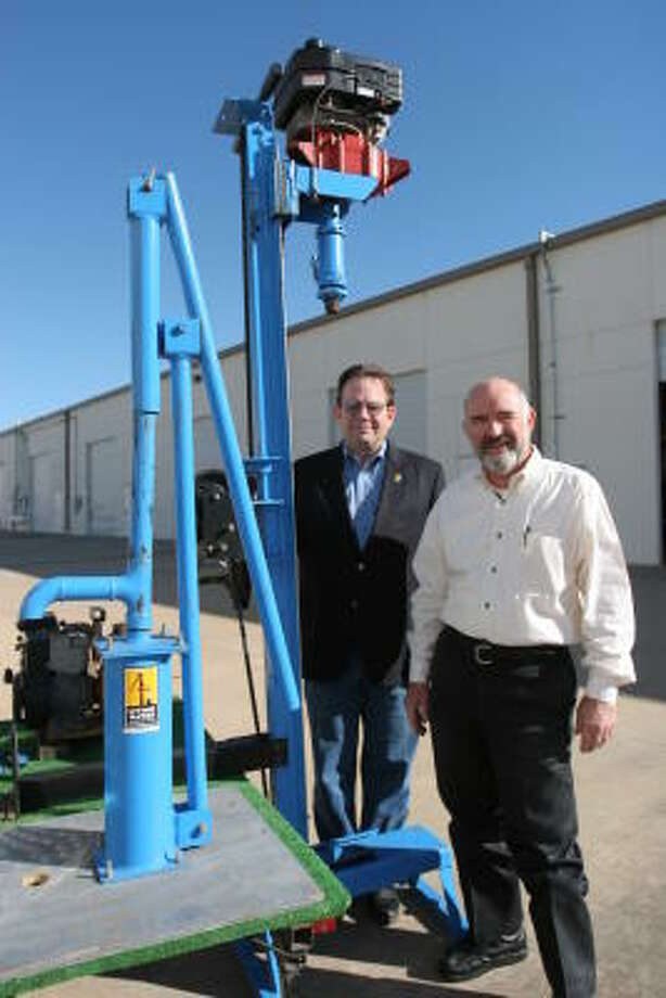 Gary Evans, left, and Harry Westmoreland of Living Water International, 4100 Greenbriar Drive in Stafford,  say the LS200 drill invented by Westmoreland is a simple, effective drill used in 22 developing countries to produce fresh water for  people. Photo: Suzanne Rehak, For The Chronicle