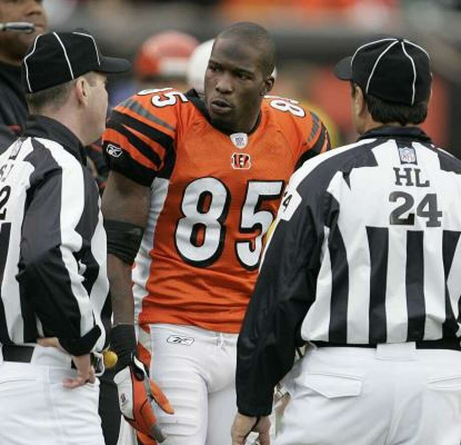 The Bengals' Chad Johnson checks in with the officials. Cincinnati won its fourth in a row. Photo: David Maxwell, Getty Images