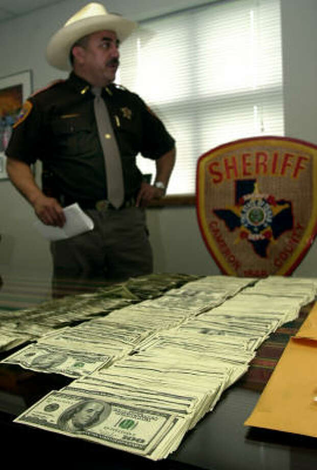 Before:In June 2003, Cameron County Sheriff Conrado Cantu holds a news conference to announce the seizure of more than $40,000 during the search of a bus outside a Brownsville convenience store. Photo: BRAD DOHERTY, For The Chronicle