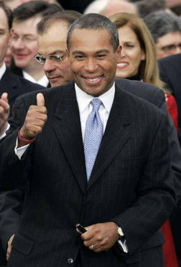Deval Patrick took the oath of office by placing his hand on a Bible given to John Quincy Adams by slaves the sixth president helped free. Photo: Elise Amendola, AP