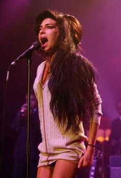 British soul singer Amy Winehouse performs during her concert at the Volkshaus in Zurich, Switzerland, in this Oct. 25, 2007, file photo.   (AP Photo/Keystone, Steffen Schmidt)