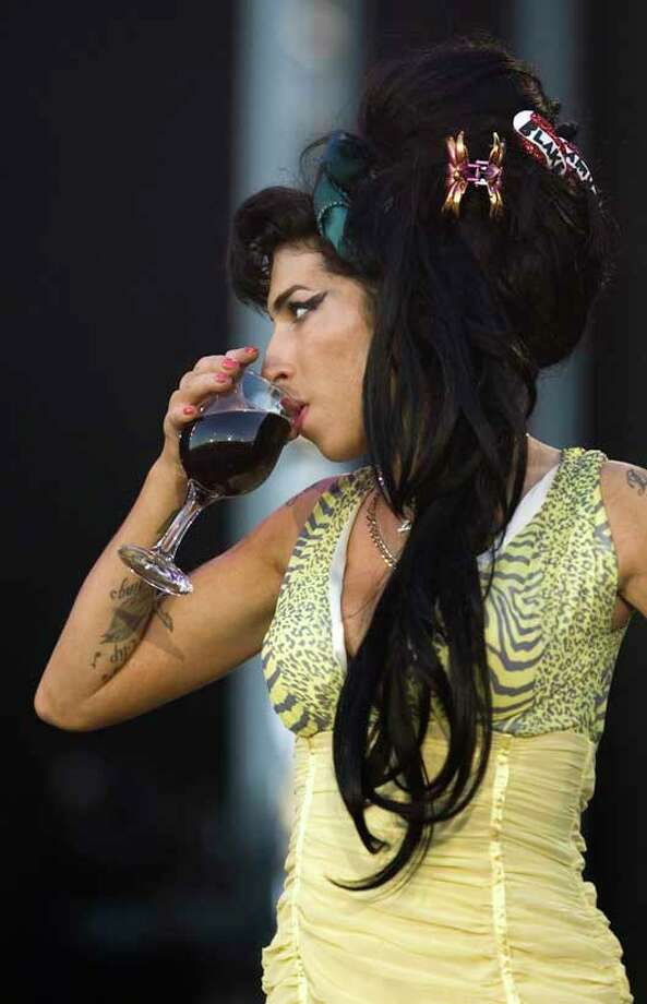 In this July 4, 2008 file photo, singer Amy Winehouse from England performs during the Rock in Rio music festival in Arganda del Rey, on the outskirts of Madrid.  (AP Photo/Victor R. Caivano, File)