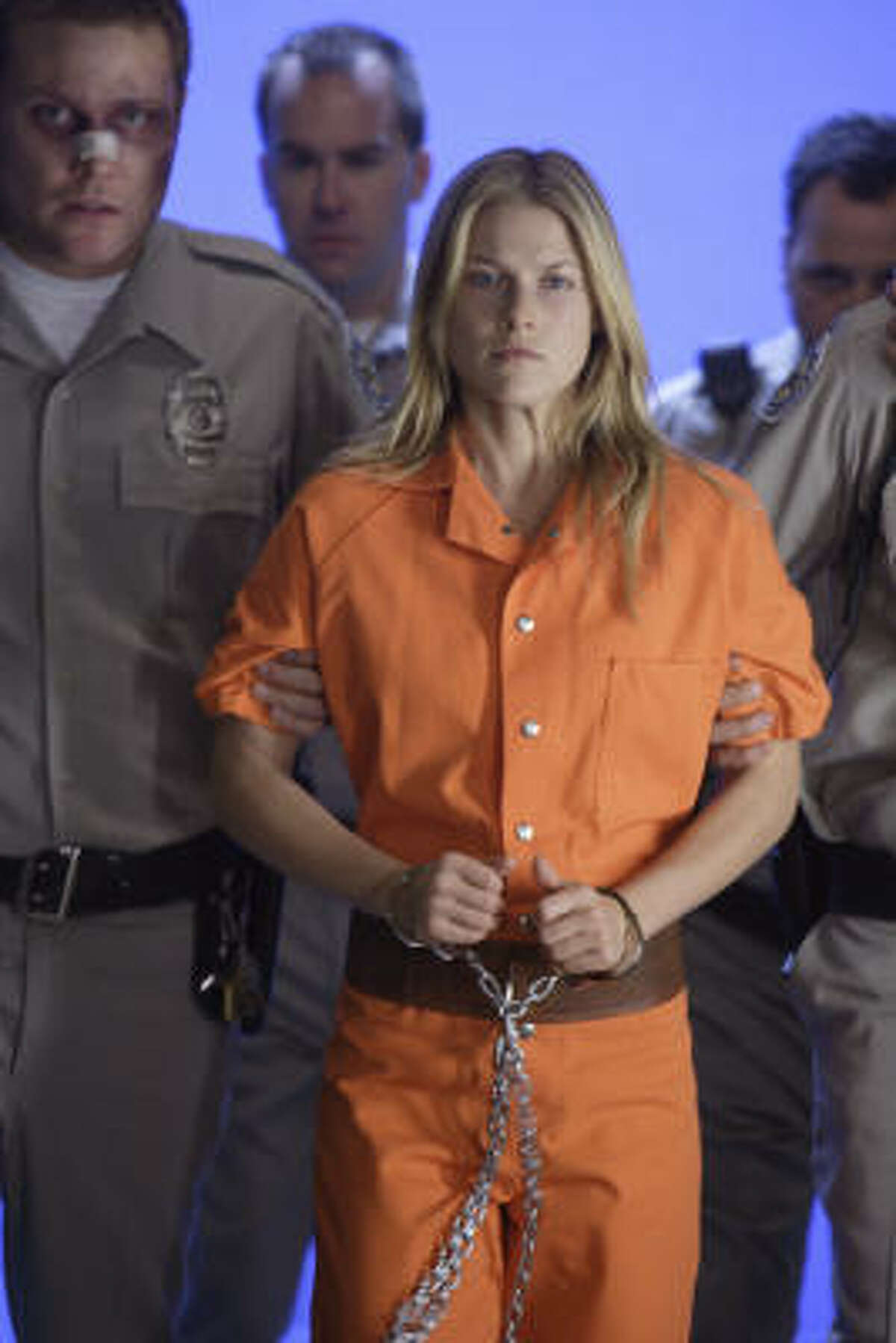 A bruised and bandaged prison guard escorts Nikki (Ali Larter) on Monday's episode of Heroes.