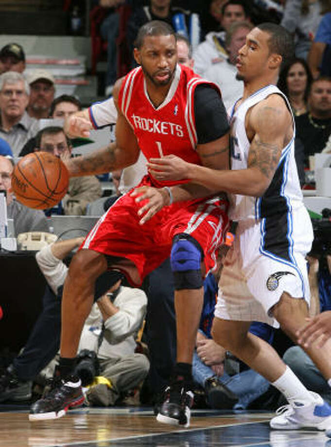 Tracy McGrady posts up Magic guard Courtney Lee in the second quarter. Photo: Gary W. Green, MCT
