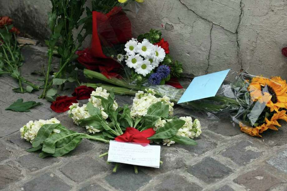 Floral tributes are left outside Amy Winehouse's North London home on July 23, 2011 in London, England. Photo: Neil Mockford, Getty Images / 2011 Getty Images