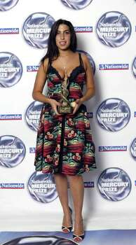 "LONDON - SEPTEMBER 7:  (UK TABLOID NEWSPAPERS OUT)  Singer Amy Winehouse poses in the pressroom at the annual ""Nationwide Mercury Music Prize"" at the Grosvenor House on September 7, 2004 in London. The 12-albums short listed this year were Basement Jaxx (Kish Kash), Belle & Sebastian (Dear Catastrophe Waitress), Franz Ferdinand (Franz Ferdinand), Jamelia (Thank You), Keane (Hopes and Fears), Snow Patrol (Final Straw), Joss Stone (The Soul Sessions, The Streets (A Grand Don't Come For Free), Ty (Upwards), Amy Winehouse (Frank), Robert Wyatt (Cuckooland) and The Zutons (Who Killed The Zutons). Photo: Dave Hogan, Getty Images / 2004 Getty Images"