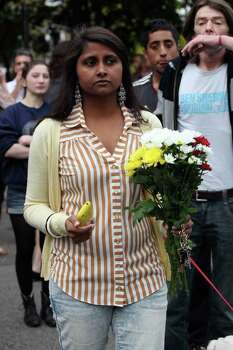 LONDON, UNITED KINGDOM - JULY 23: A mourner carries flowers outside Amy Winehouse's North London Home on July 23, 2011 in London, England. Singer Winehouse, 27, was found dead today. Photo: Neil Mockford, Getty Images / 2011 Getty Images