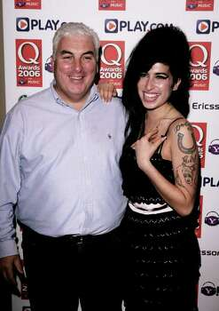 LONDON - OCTOBER 30:  (UK TABLOID NEWSPAPERS OUT)  Singer Amy Winehouse and her father Mitch pose in the awards room at the Q Awards 2006 at Grosvenor House Hotel on October 30, 2006 in London, England. Photo: Dave Hogan, Getty Images / 2006 Getty Images