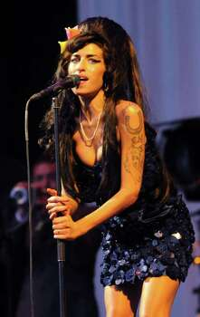GLASTONBURY, UNITED KINGDOM - JUNE 28:  Amy Winehouse performs on the Pyramid stage during day two of the Glastonbury Festival at Worthy Farm, Pilton on June 28, 2008 in Glastonbury, Somerset, England. Photo: Jim Dyson, Getty Images / 2008 Getty Images