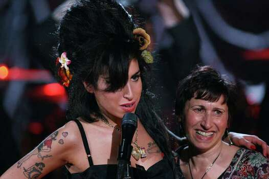 LONDON - FEBRUARY 10:  British singer Amy Winehouse performs at the Riverside Studios for the 50th Grammy Awards ceremony via video link on February 10, 2008 in London, England.  Winehouse won 5 out of her 6 nominations including, record of the year, best new artist, song of the year, pop vocal album and female pop vocal performance.  (Photo by Peter Macdiarmid/Getty Images for NARAS) *** Local Caption *** Amy Winehouse;Janis Photo: Peter Macdiarmid, Getty Images For NARAS / 2008 Getty Images