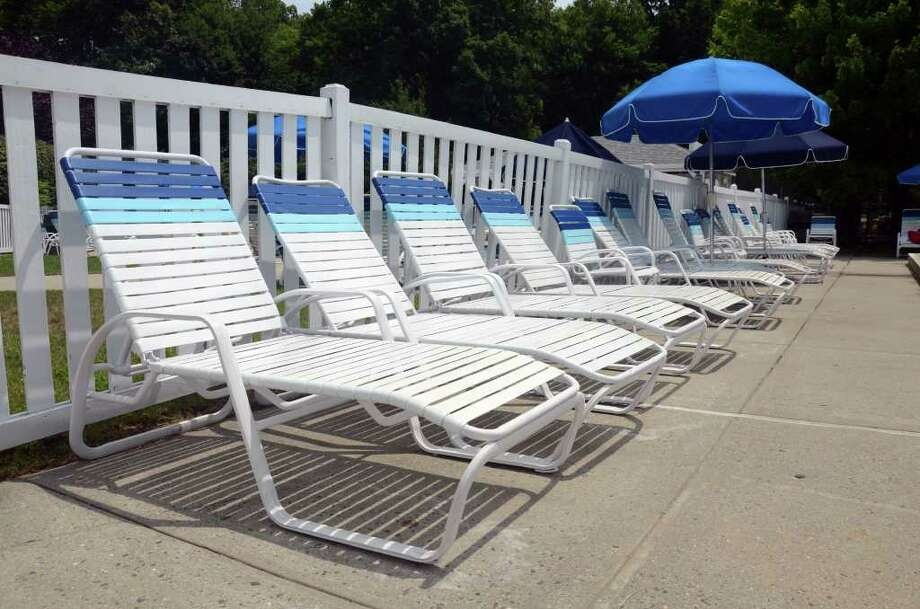 Lounge chairs remain unoccupied at the Newfield Swim and Tennis Club pool on Red Bird Road in Stamford on Saturday, July 23, 2011. The water temperature was 90 degrees offering little relief from the heat wave. Photo: Amy Mortensen