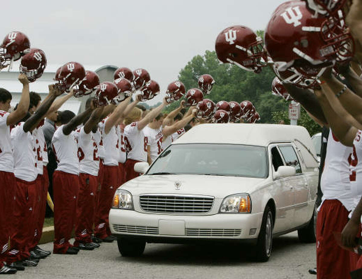 Members of the Indiana football team pay their respects to coach Terry Hoeppner during a memorial services that followed Hoeppner's death on June 19.