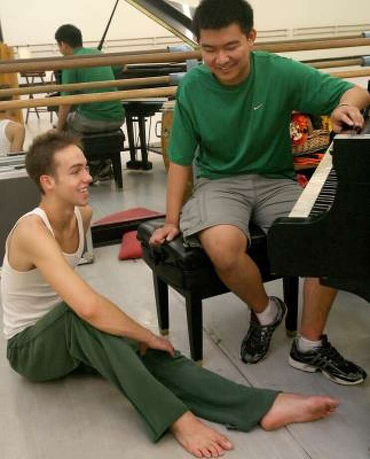 Garrett Smith, left, and Derek Zhao have worked hard for a piece to debut Thursday at World Premieres Concert at Zilkha Hall in the Hobby Center. Photo: BILL OLIVE, FOR THE CHRONICLE