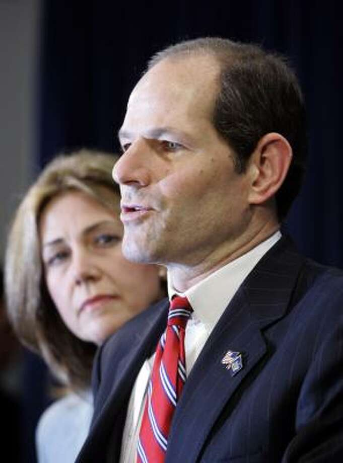 New York State Gov. Elliot Spitzer is joined by his wife, Silda, as he makes a statement to reporters following a report that he was involved in a prostitution ring. Photo: Mary Altaffer, Associated Press