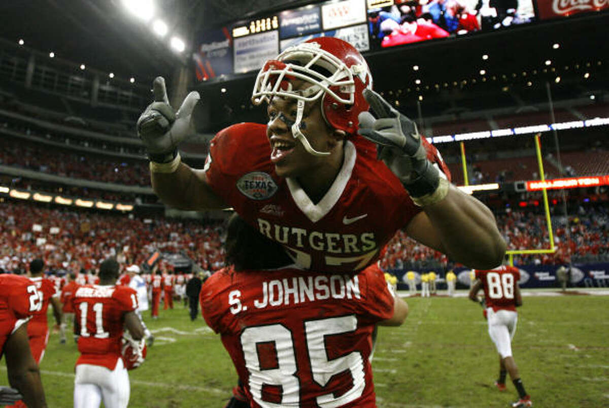 Rutgers tight end Sam Johnson hoists running back Ray Rice after the beating Kansas State in the Texas Bowl.