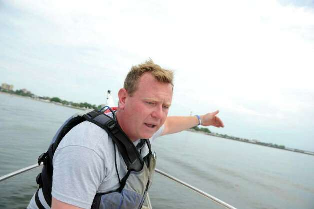 Chris German, executive director and founder of Connecticut Community Boating (CCB), talks about boating and the Gathering of the Vibes festival at Seaside Park in Bridgeport, Conn. Photo: Autumn Driscoll / Connecticut Post Staff