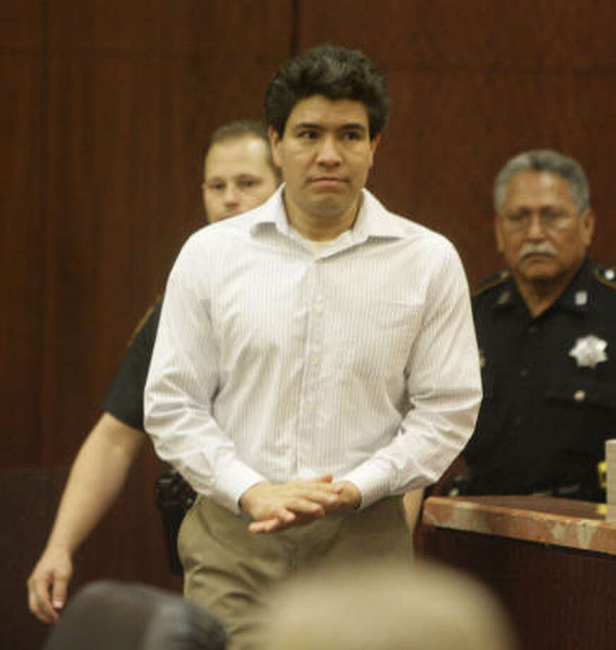 Juan Leonardo Quintero enters the courtroom for the first day of his death penalty trial. Photo: Julio Cortez, Chronicle