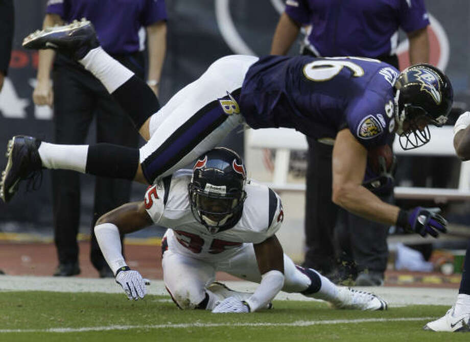 Ravens tight end Todd Heap is upended by Texans cornerback Jacques Reeves during the second quarter. Photo: Melissa Phillip, Chronicle