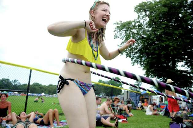 Kate Vorstadt, of New York, NY, hula hoops during the Gathering of the Vibes festival at Seaside Park in Bridgeport, Conn. Saturday, July 23, 2011. Photo: Autumn Driscoll / Connecticut Post Staff