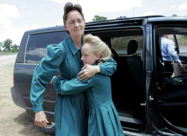 On June 2, 2008, Nancy Dockstader, left, a member of the Fundamentalist Church of Jesus Christ of Latter Day Saints, embraces her daughter Amy, 9, after they were reunited at the Baptist Children's Home Ministries Youth Camp near Lulling, Texas. Members of the Fundamentalist Church of Jesus Christ of Latter Day Saints, a radical offshoot of mainstream Mormonism that believes polygamy is the key to heaven, were subject of a SWAT team raid where 439 children seized from mothers. Photo: Eric Gay, STF / AP2008