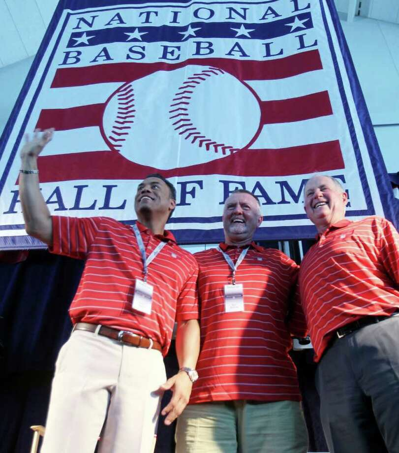 Roberto Alomar, left, Bert Blyleven, center, and Pat Gillick pose together after a news conference in Cooperstown, N.Y., on Saturday, July 23, 2011. All three will be inducted into the Baseball Hall of Fame on Sunday. (AP Photo/Mike Groll) Photo: Mike Groll
