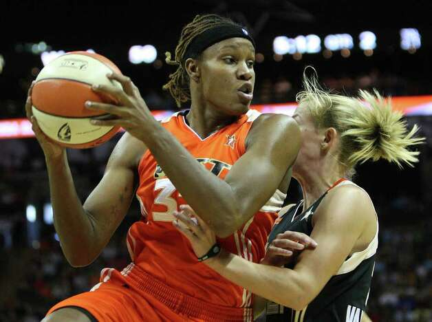 Rebekkah Brunson of the Minnesota Lynx controls a rebound during the WNBA All-Star Game at the AT&T Center on July 23, 2011.  ANDREW BUCKLEY / abuckley@express-news.net Photo: ANDREW BUCKLEY, Express-News / abuckley@express-news.net
