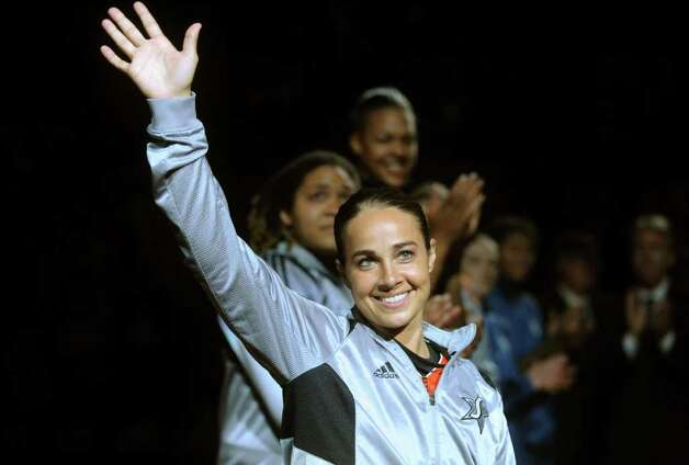 Becky Hammon of the San Antonio Silver Stars acknowledges the crowd before the WNBA All-Star Game at the AT&T Center on Saturday, July 23, 2011. BILLY CALZADA / gcalzada@express-news.net Photo: BILLY CALZADA, Express-News / gcalzada@express-news.net