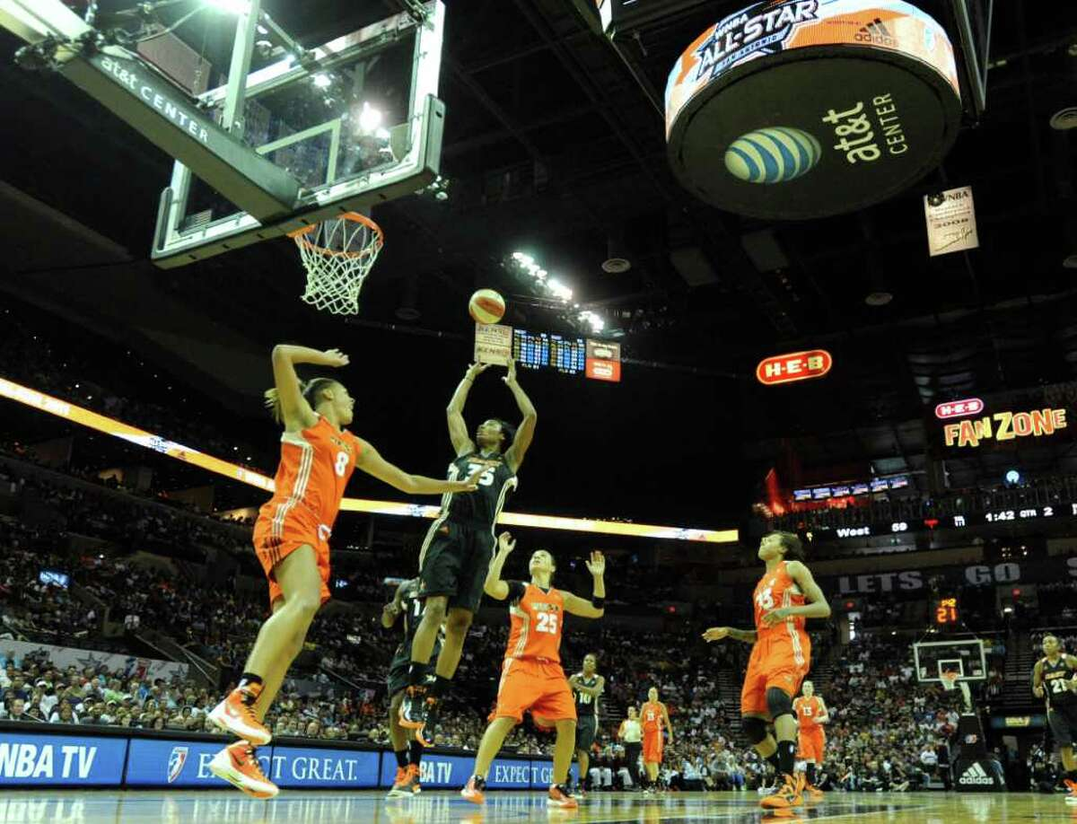 Angel McCoughtry (35) of the East shoots after bouncing the ball offof the backboard to score during the WNBA All-Star Game at the AT&T Center on Saturday, July 23, 2011. BILLY CALZADA / gcalzada@express-news.net