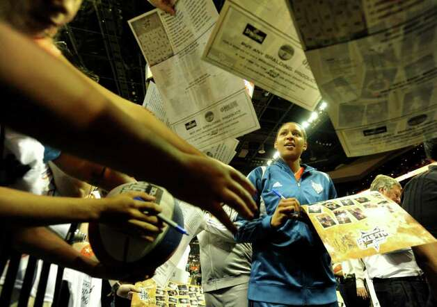 Maya Moore of the Minnesota Lynx signs autographs for fans before the WNBA All-Star Game at the AT&T Center on Saturday, July 23, 2011. BILLY CALZADA / gcalzada@express-news.net Photo: BILLY CALZADA, Express-News / gcalzada@express-news.net