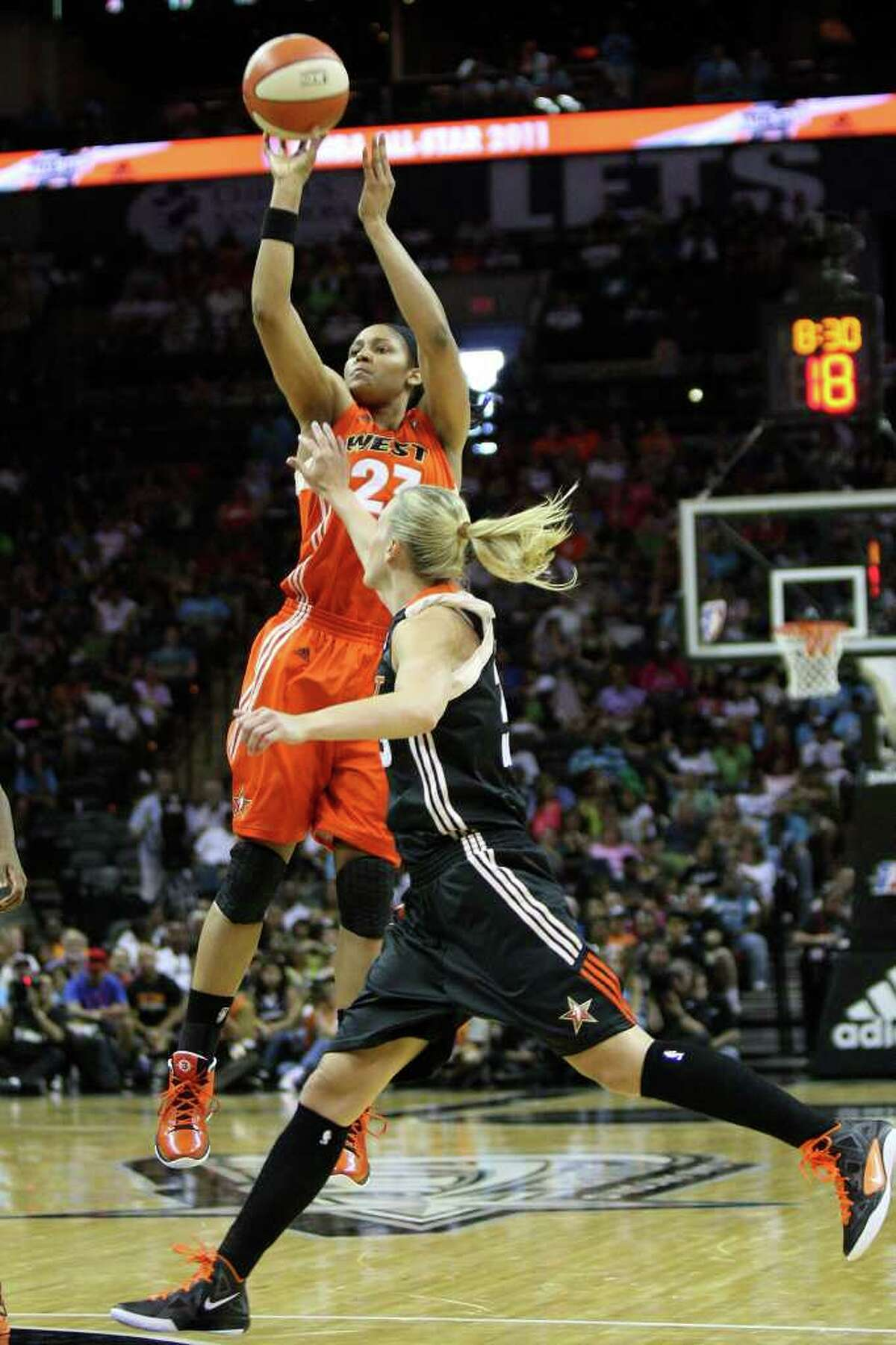Maya Moore of the Minnesota Lynx shoots during the WNBA All-Star Game at the AT&T Center on July 23, 2011. ANDREW BUCKLEY / abuckley@express-news.net