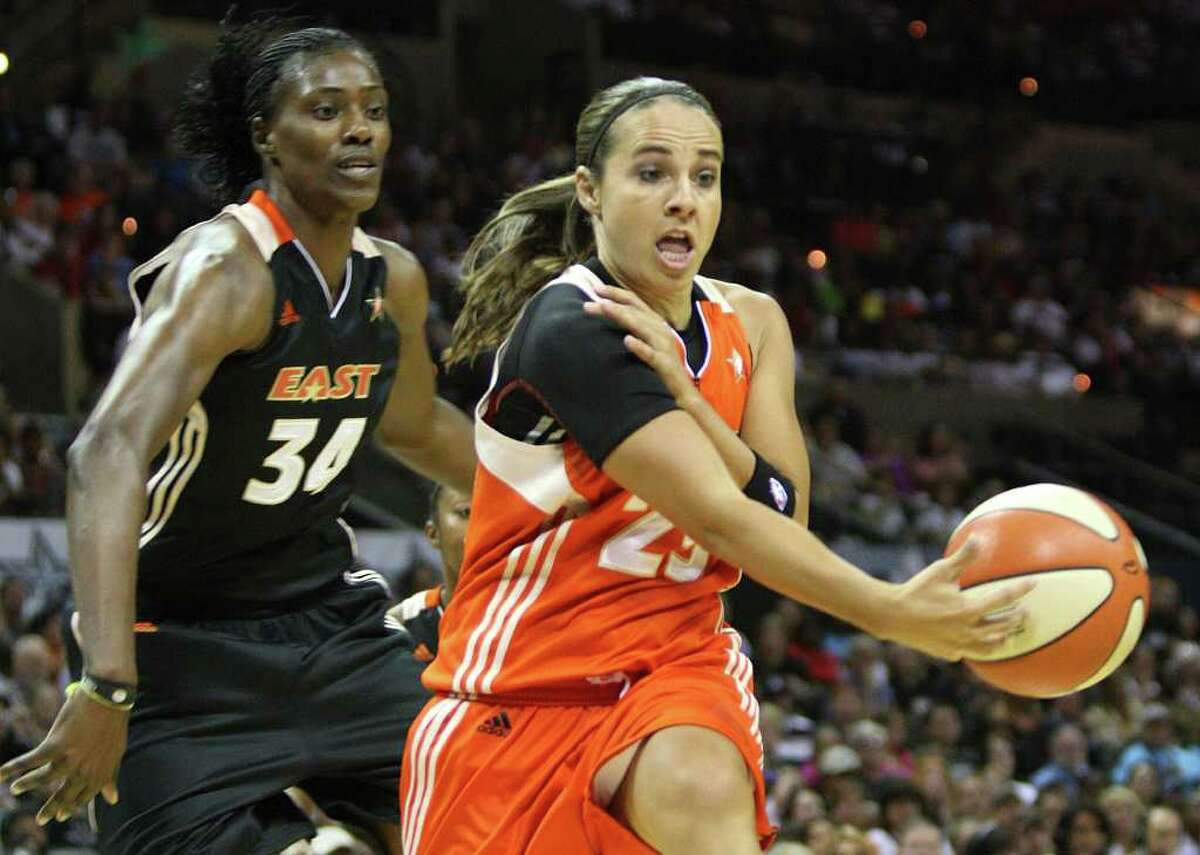 Becky Hammon of the San Antonio Silver Stars throws a no-look pass during the WNBA All-Star Game at the AT&T Center on July 23, 2011. ANDREW BUCKLEY / abuckley@express-news.net