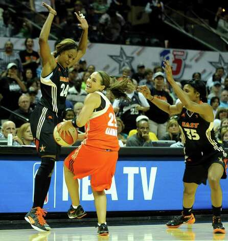 Becky Hammon (25) of the West team is tied up by Tamika Catching, left, and Angel McCoughtry as time runs down on the East's 118-113 victory in the WNBA All-Star Game at the AT&T Center on Saturday, July 23, 2011. BILLY CALZADA / gcalzada@express-news.net Photo: BILLY CALZADA, Express-News / gcalzada@express-news.net