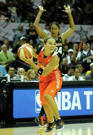 Becky Hammon of the West team is called for traveling as the game clock winds down on the West's 118-113 loss to the East during the WNBA All-Star Game at the AT&T Center on Saturday, July 23, 2011. BILLY CALZADA / gcalzada@express-news.net Photo: BILLY CALZADA, Express-News / gcalzada@express-news.net