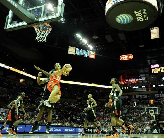 Becky Hammon of the West team shoots a layup during the WNBA All-Star Game at the AT&T Center on Saturday, July 23, 2011. Hammon plays for the San Antonio Silver Stars. BILLY CALZADA / gcalzada@express-news.net Photo: BILLY CALZADA, Express-News / gcalzada@express-news.net