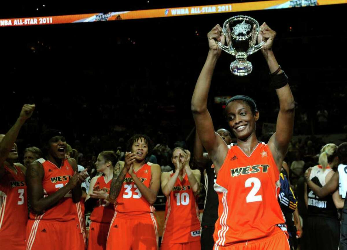 WNBA All-Star Game MVP Swin Cash holds up her trophy after the East beat the West, 118-113 in the WNBA All-Star Game at the AT&T Center on Saturday, July 23, 2011. BILLY CALZADA / gcalzada@express-news.net