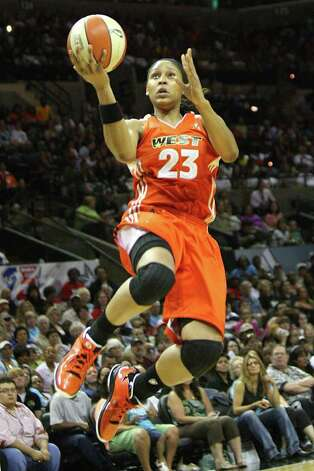 Maya Moore of the Minnesota Lynx leaps for a layup during the WNBA All-Star Game at the AT&T Center on July 23, 2011.  ANDREW BUCKLEY / abuckley@express-news.net Photo: Express-News