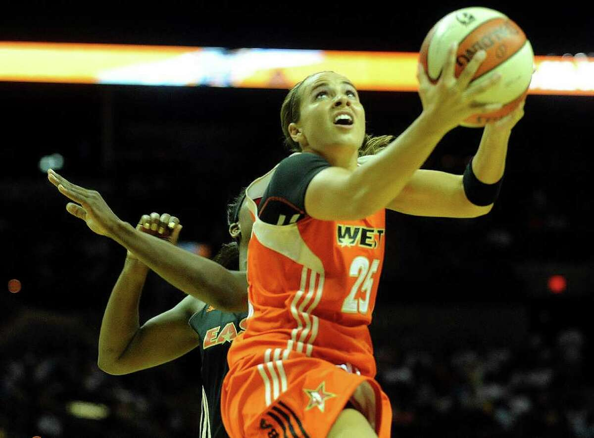 Becky Hammon of the West team shoots a layup during the WNBA All-Star Game at the AT&T Center on Saturday, July 23, 2011. BILLY CALZADA / gcalzada@express-news.net