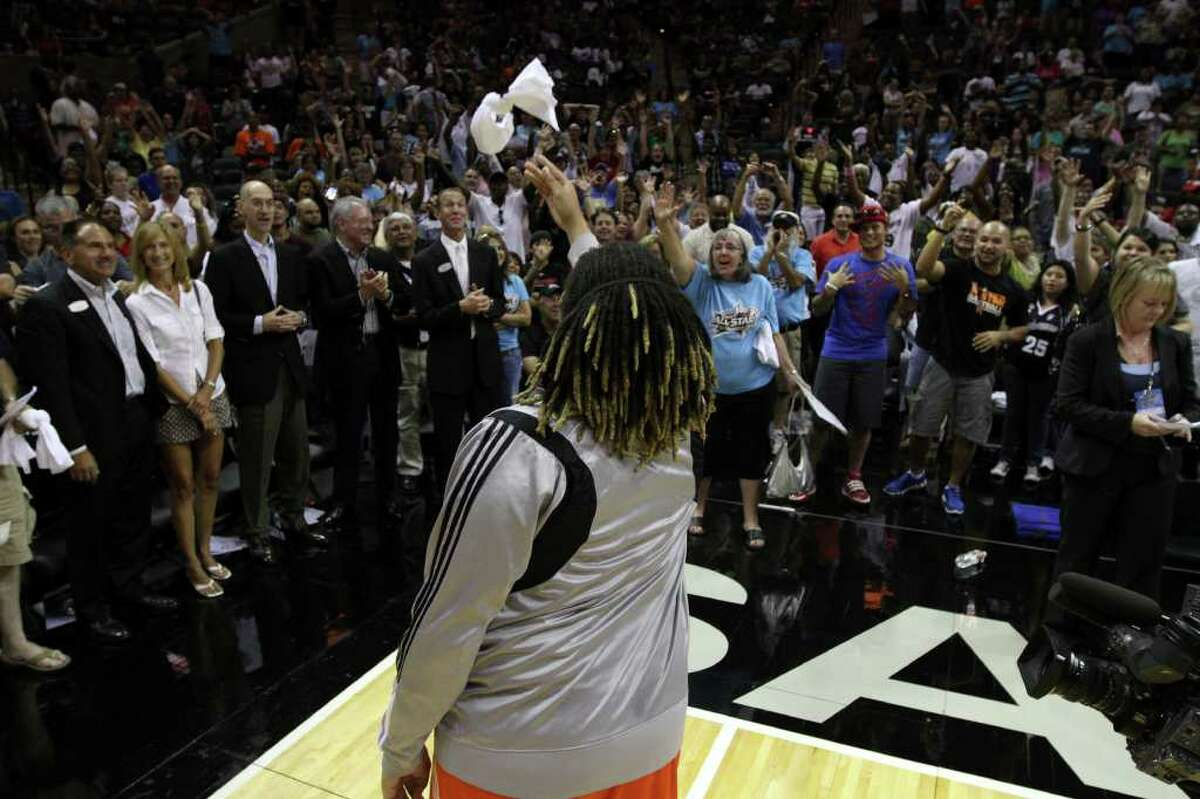 Danielle Adams of the San Antonio Silver Stars throws a t-shirt to the crowd after the WNBA All-Star Game at the AT&T Center on July 23, 2011. ANDREW BUCKLEY / abuckley@express-news.net