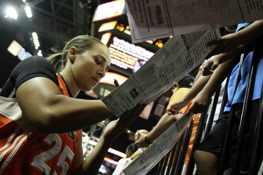 Becky Hammon of the San Antonio Silver Stars signs autographs after the WNBA All-Star Game at the AT&T Center on July 23, 2011.  ANDREW BUCKLEY / abuckley@express-news.net Photo: ANDREW BUCKLEY, Express-News / Andrew Buckley