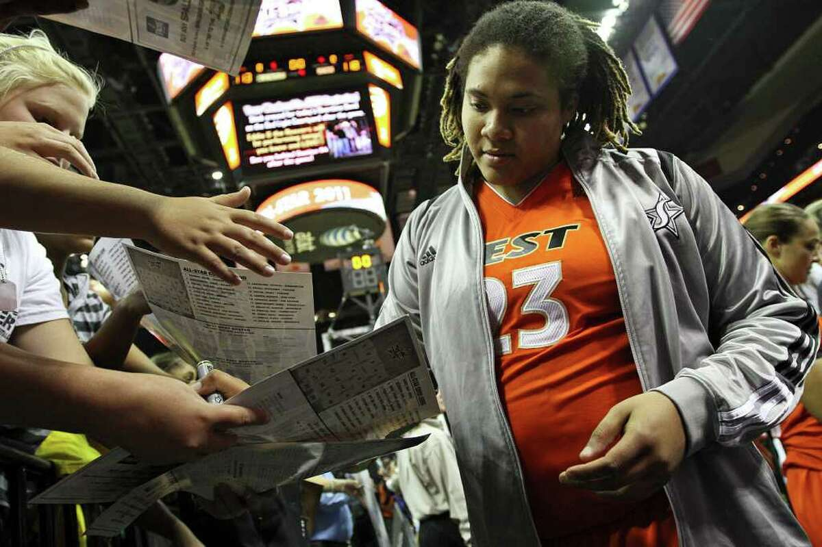 Danielle Adams of the San Antonio Silver Stars signs autographs after the WNBA All-Star Game at the AT&T Center on July 23, 2011. ANDREW BUCKLEY / abuckley@express-news.net